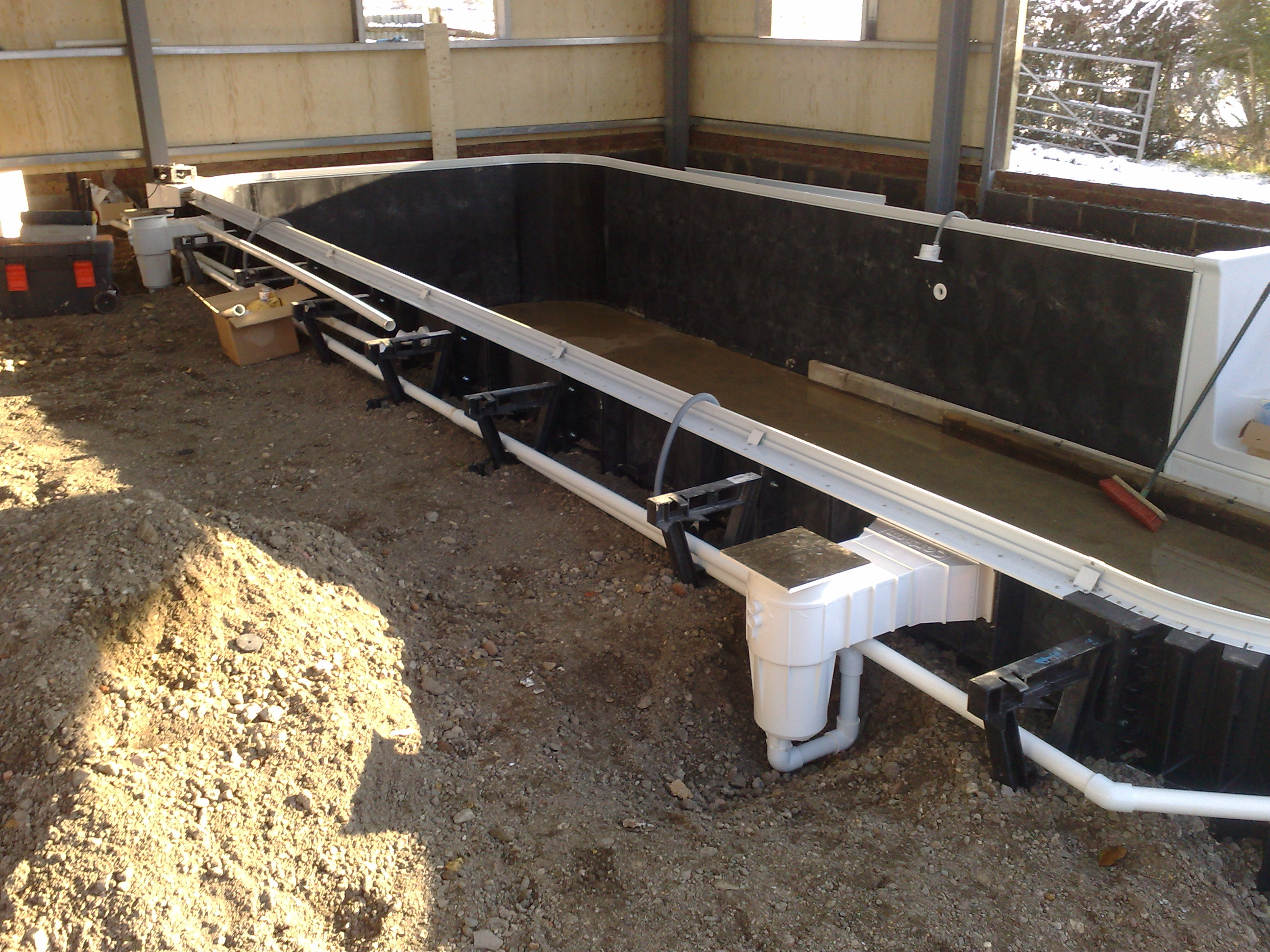 Kafko Polymer Panel swimming pool under construction - skimmer and pipework