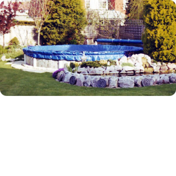 Winter debris cover on round above ground pool